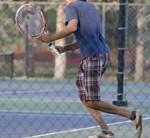 テニスをしている人