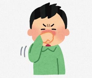 鼻を触る男性